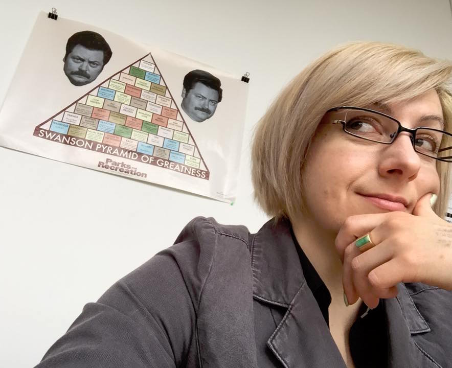 Marie Hicks in her office with the Ron Swanson Pyramid of Greatness.